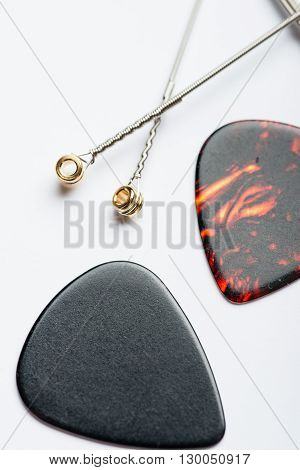 Electric Guitar Strings With Two Mediators On White Surface