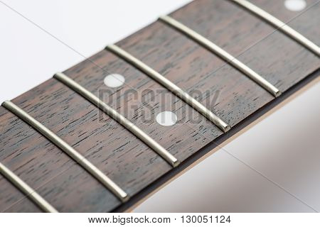 Electric guitar frets without strings on white