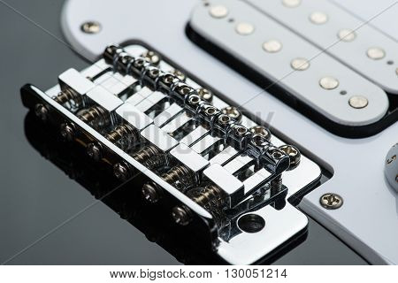 Shiny electric guitar bridge with new bolts