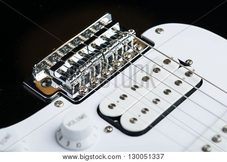 Electric guitar bridge with new strings installed