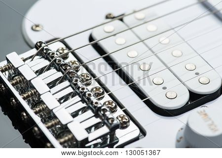 Shiny electric guitar bridge with new strings