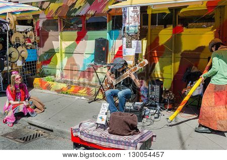 Street Artists Play On Instruments At Farmer's Market