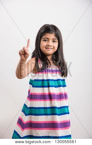 indian small girl counting one, asian small girl showing 1 finger or one number with index finger