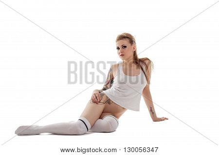 Nude. Image of beautiful girl with tattooed body