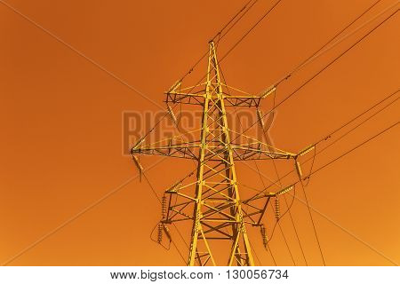 High tower power line on red sky background