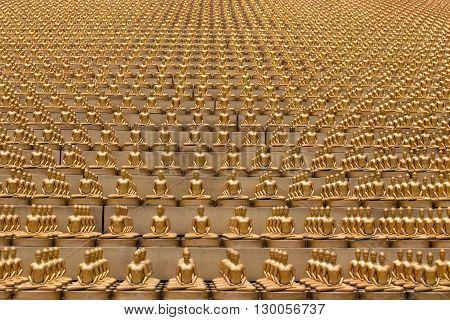 Million golden Buddha figurine in Wat Phra Dhammakaya. Buddhist temple in Bangkok Thailand