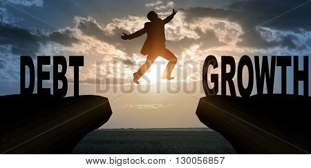 Businessman with hopping over abyss from debt to growth