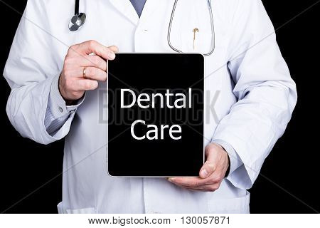 technology, internet and networking in medicine concept - Doctor holding a tablet pc with dental care sign. Internet technologies in medicine.