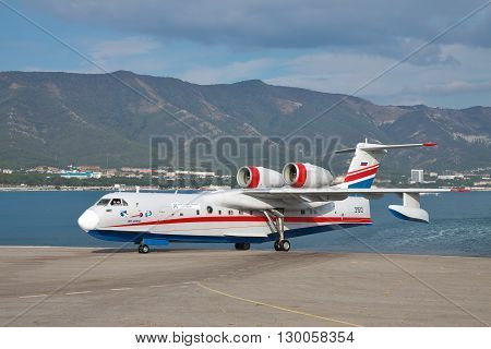 Gelendzhik Russia - September 8 2010: Beriev Be-200 amphibian cargo and firefighter plane is taxiing from the ramp to the apron