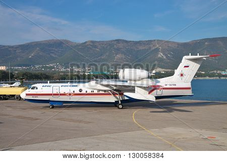 Gelendzhik Russia - September 8 2010: Beriev Be-200 amphibian cargo and firefighter plane is taxiing along the apron to the parking site