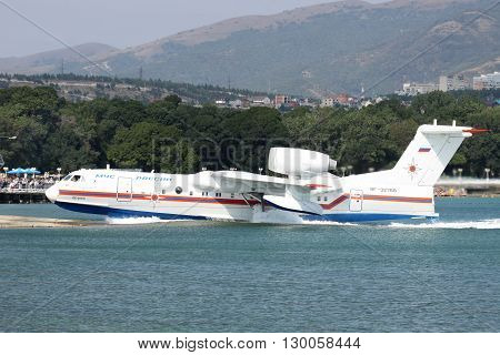 Gelendzhik Russia - September 8 2010: Beriev Be-200 amphibian cargo and firefighter plane is getting out of the water to the ramp
