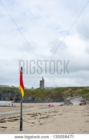 red and yellow warning flag at ballybunion beach ireland on the wild atlantic way