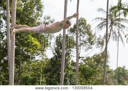 KOH PHANGAN. THAILAND - NOVEMBER 25 2014 : Unidentified man jump in the pool in the attraction Slip N Fly on island Koh Phangan