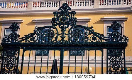 Ornate black iron gate in Lisbon Portugal