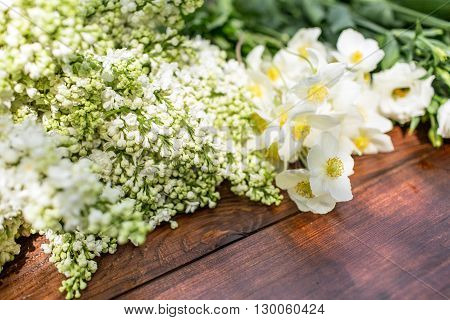White Flowers On A Wooden Table.