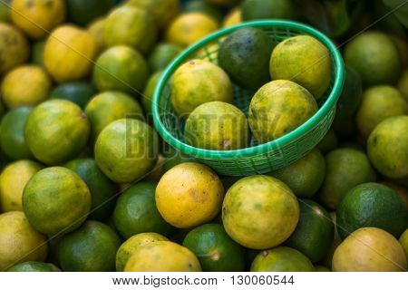 Yellow Lemons and Green lemons in the basket