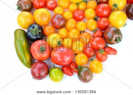 Heirloom colorful tomatoes fruits on white background