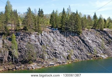 RUSKEALA, KARELIA, RUSSIA - MAY 14, 2016: People look at The Marble Canyon from observation deck in The Mountain Park