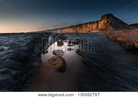 Nash Point Rock Pool The Heritage Coast, South Wales, which features a 'Welsh Sphinx' like cliff face