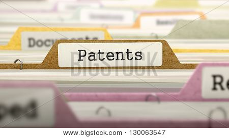 File Folder Labeled as Patents in Multicolor Archive. Closeup View. Blurred Image. 3D Render.