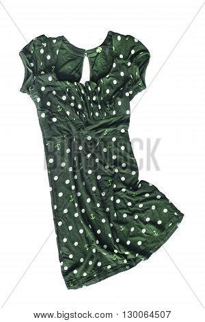 Crumpled green tunic with polka dots on white background