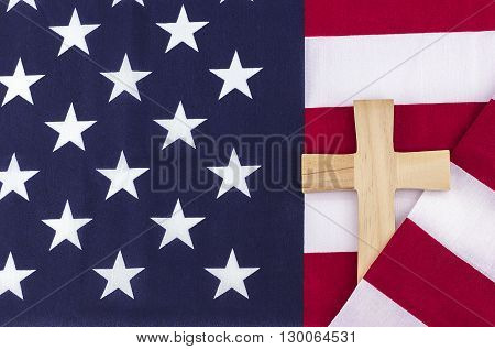 Wooden cross wrapped in an American flag