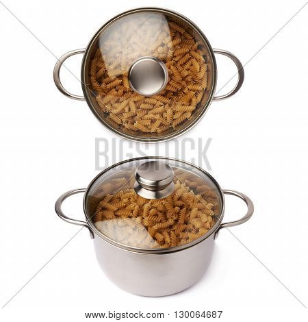 Metal pan with glass lid filled with dry rotini yellow pasta over isolated white background