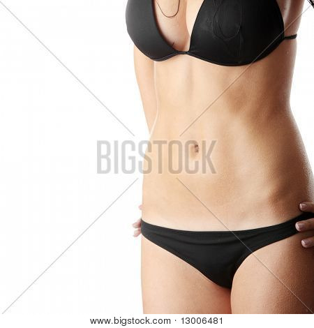 Beautiful wet caucasian woman in black bikini isolated on white background