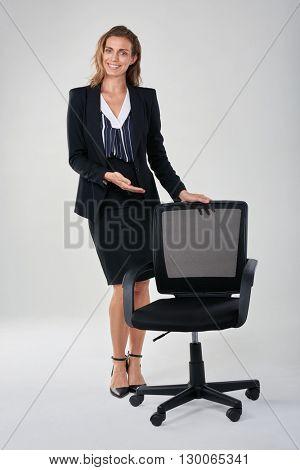 Caucasian business woman showing empty office chair, hiring recruitment vacancy employment concept