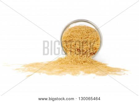 Glass jar filled with dry noodles yellow pasta over isolated white background