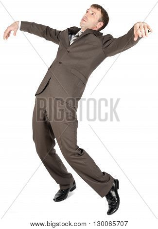 Falling businessman in formal wear over white background