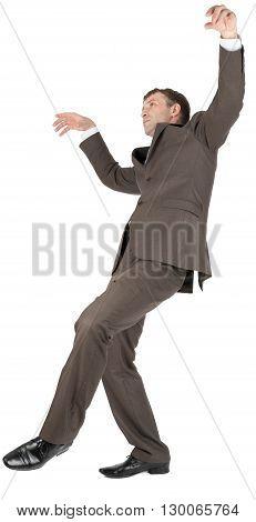 Businessman slipping on banana peel isolated on white background