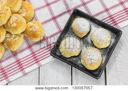 Top View on Sugared Czech Traditional Wedding Leavened Curds Cakes on a Black Tray
