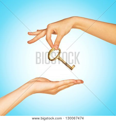 Hand giving key to another hand. Giving help, opportunity, success concept
