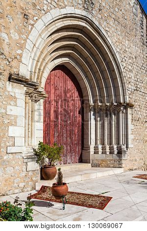 Close up on the Gothic portal of the medieval church of Santa Cruz. 13th century Gothic Architecture. Santarem, Portugal.