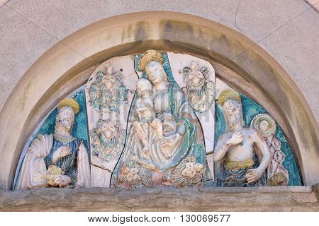 LUCCA, ITALY - JUNE 06, 2015: Virgin Mary with baby Jesus and Saints on the portal of the Saint Joseph church in Lucca, Italy, on June 06, 2015