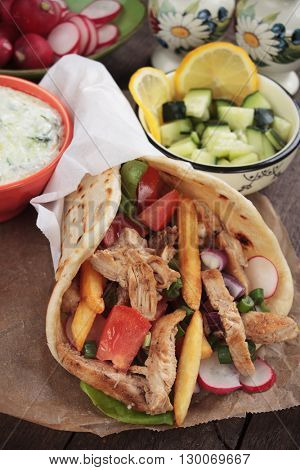 Turkish doner kebab, pita bread wrapped sandwich with meat slices and fresh vegetables