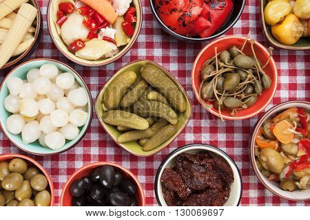 Pickled cucumber, olives, onion, peppers and other vegetables