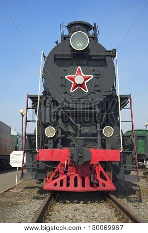 SAINT PETERSBURG, RUSSIA - MARCH 30, 2016: The old freight locomotive LV18 on the railroad in St. Petersburg, front view. Historical landmark