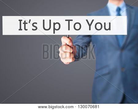 It's Up To You - Businessman Hand Holding Sign