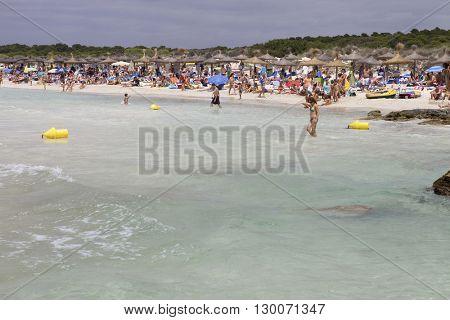 MAIORCA, SPAIN - MARCH 13: people at the beach, on March 13, 2016 in Palma de Maiorca, Maiorca Island, Spain