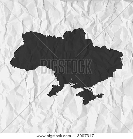 Ukraine map in black on a background crumpled paper