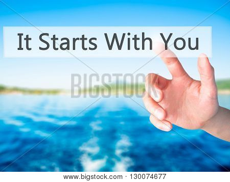It Starts With You - Hand Pressing A Button On Blurred Background Concept On Visual Screen.