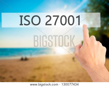 Iso 27001 - Hand Pressing A Button On Blurred Background Concept On Visual Screen.