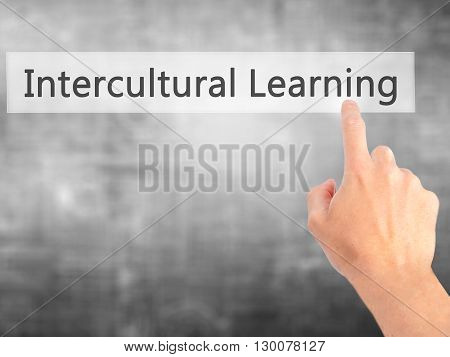 Intercultural Learning - Hand Pressing A Button On Blurred Background Concept On Visual Screen.