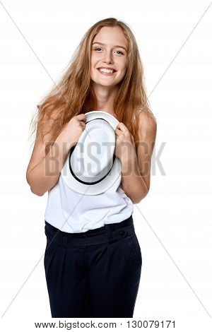 Happy excited woman with straw hat smiling at camera