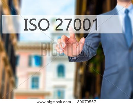 Iso 27001 - Businessman Hand Pressing Button On Touch Screen Interface.