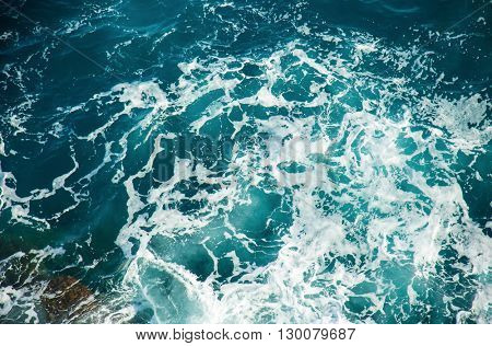 Background shot of clear sea water surface, close-up.
