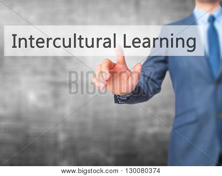 Intercultural Learning - Businessman Hand Pressing Button On Touch Screen Interface.