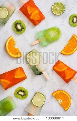 Fresh summer fruit popsicles on white  marble